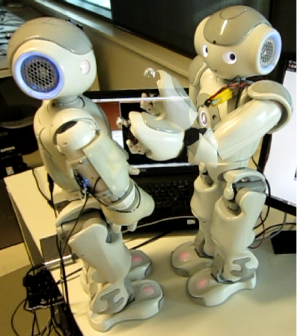 A Nao equipped with a tactile sensitive fingertip performing a stroke on another tactile sensitive Nao